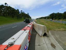 Plastic barrier overlap treatment with concrete barriers.