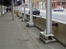 Are these columns designed to withstand impact loads transferred from the barrier?